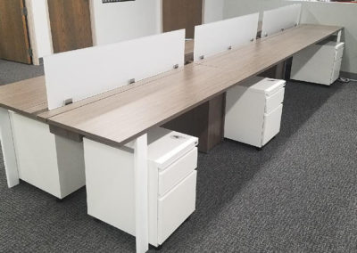 Long work stations with movable file cabinets