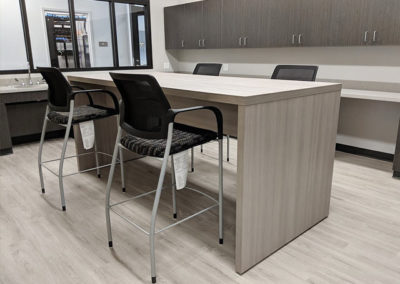 Community table with chairs in break room