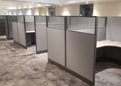 Cubicle partitions installed around modular workstations