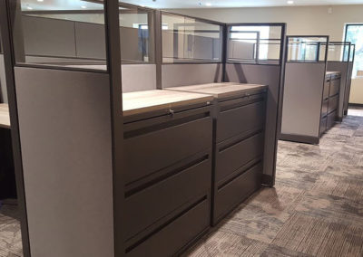 Filing cabinets installed to fit perfectly in cubicle partitions